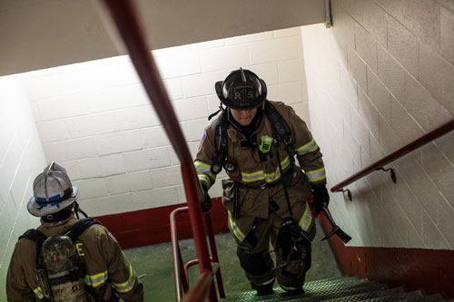 firefighter climbing stairs